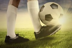 Football player with a ball on the grass Royalty Free Stock Photos