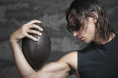 Football player and ball. Football player with his ball in arm Royalty Free Stock Photos