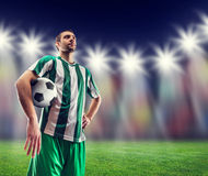 Football-player with a ball Stock Photos