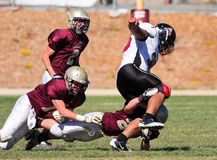 Football Player Being Tackled During a Game. A football players from Scotts Valley High School, tackle another player during a game against Aragon High school in Stock Image