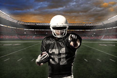 Football Player. With a black uniform celebrating on a stadium Stock Photo
