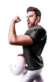Football Player on black uniform isolated on white background Royalty Free Stock Photography