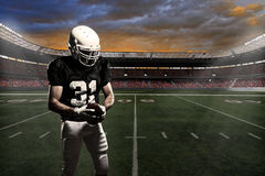 Football Player. With a black uniform, in a stadium Stock Image