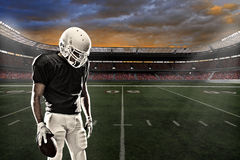 Football Player. With a black uniform, in a stadium Stock Photo