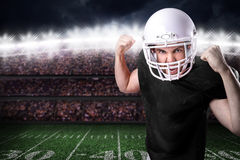 Football Player on black uniform in the stadium Royalty Free Stock Images