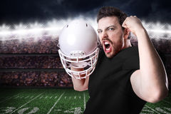 Football Player on black uniform in the stadium Stock Images