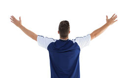 Football player in blue celebrating a victory Royalty Free Stock Photos