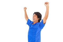 Football player in blue celebrating a victory Royalty Free Stock Photography