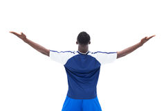 Football player in blue celebrating a win Stock Photo