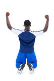 Football player in blue celebrating a win Royalty Free Stock Images