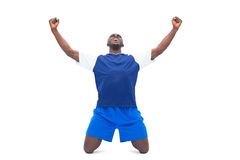 Football player in blue celebrating a win Royalty Free Stock Photography