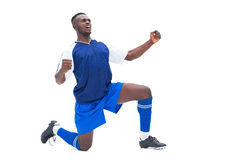 Football player in blue celebrating a win Royalty Free Stock Photos