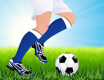 Football player in blue gaiters Stock Photography