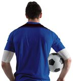 Football player in blue holding ball Stock Photos