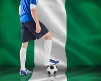 Football player in blue jersey Royalty Free Stock Images