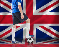 Football player in blue jersey Royalty Free Stock Photos