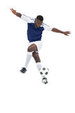 Football player in blue jersey controlling ball. On white background Stock Images