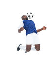 Football player in blue jersey controlling ball. On white background Royalty Free Stock Images