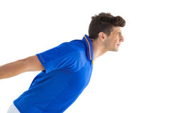 Football player in blue jersey jumping Royalty Free Stock Photography