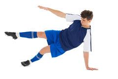 Football player in blue jersey kicking Royalty Free Stock Photos