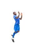 Football player in blue jumping Stock Photography