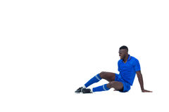 Football player in blue sitting and smiling Royalty Free Stock Photo
