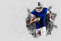 Football Player. With a Blue uniform coming out of a blast of smoke Stock Photos