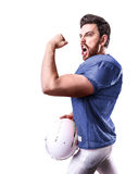 Football Player on blue uniform isolated on white background.  Royalty Free Stock Photo