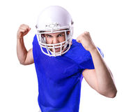 Football Player on blue uniform isolated on white background Royalty Free Stock Photos