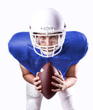 Football Player on blue uniform isolated on white background Royalty Free Stock Images