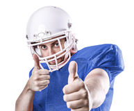 Football Player on blue uniform isolated on white background.  Royalty Free Stock Photography