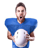 Football Player on blue uniform isolated on white background Stock Photo