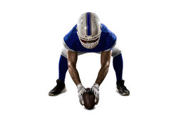 Football Player. With a blue uniform on the scrimmage line, on a white background Stock Photo