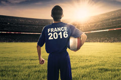 Football player carrying a ball at field Stock Images
