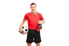 Football player carrying a pair of boots Stock Photos