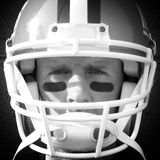 Football Player Close Up. A closeup shot of a football player wearing a helmet with an intense stare. Good shot for fantasy football or anything nfl or ncaa stock photo