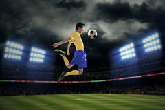 Football player controlling ball Royalty Free Stock Photography