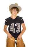 A football player in cowboy hat and chaps. A football player with his jersey and cowboy hat on, with his chaps stock photography