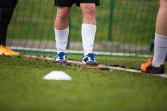 Football player crossing white line on the field. Football soccer players. Training session on a drills before soccer match Royalty Free Stock Photography