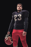 Football player on dark background Royalty Free Stock Photos