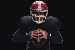 Football player on dark background Royalty Free Stock Image