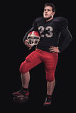 Football player on dark background Stock Image
