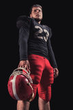 Football player on dark background Royalty Free Stock Photo
