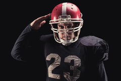 Football player on dark background Stock Images