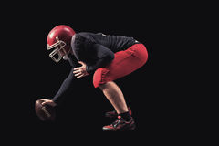 Football player on dark background Stock Photography