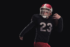 Football player on dark background Stock Photo