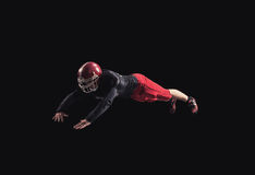 Football player on dark background Royalty Free Stock Images