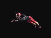 Football player on dark background Stock Photos