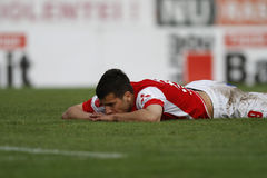 Football player disappointment. Football player (George Tucudean) shows his disappointment after missing a goal opportunity in the match between his team, Dinamo Stock Photos