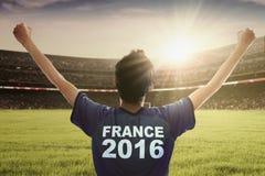 Football player of Euro 2016 raising his hands Royalty Free Stock Image